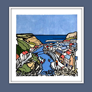 Staithes bay (showing houses and the bay) using papercut techniques and fabric for colours
