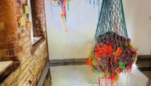 Michael Hill painting in his garden studio