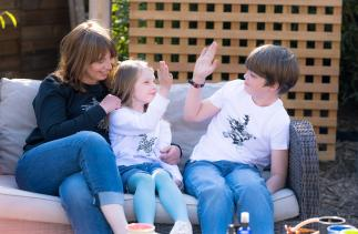 Alison, Livy and Tom wearing sweatshirts with the Livy and Tom star design