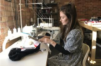 Beatrice Russell sewing one of her premium prototype sports garments