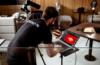 Picture of Dariusz working on a shoot in a cafe photographing food